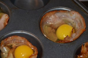 Baked eggs and bacon in muffin pan