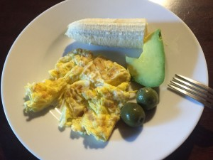 Kids breakfast -omelette, olives, avocado and banana